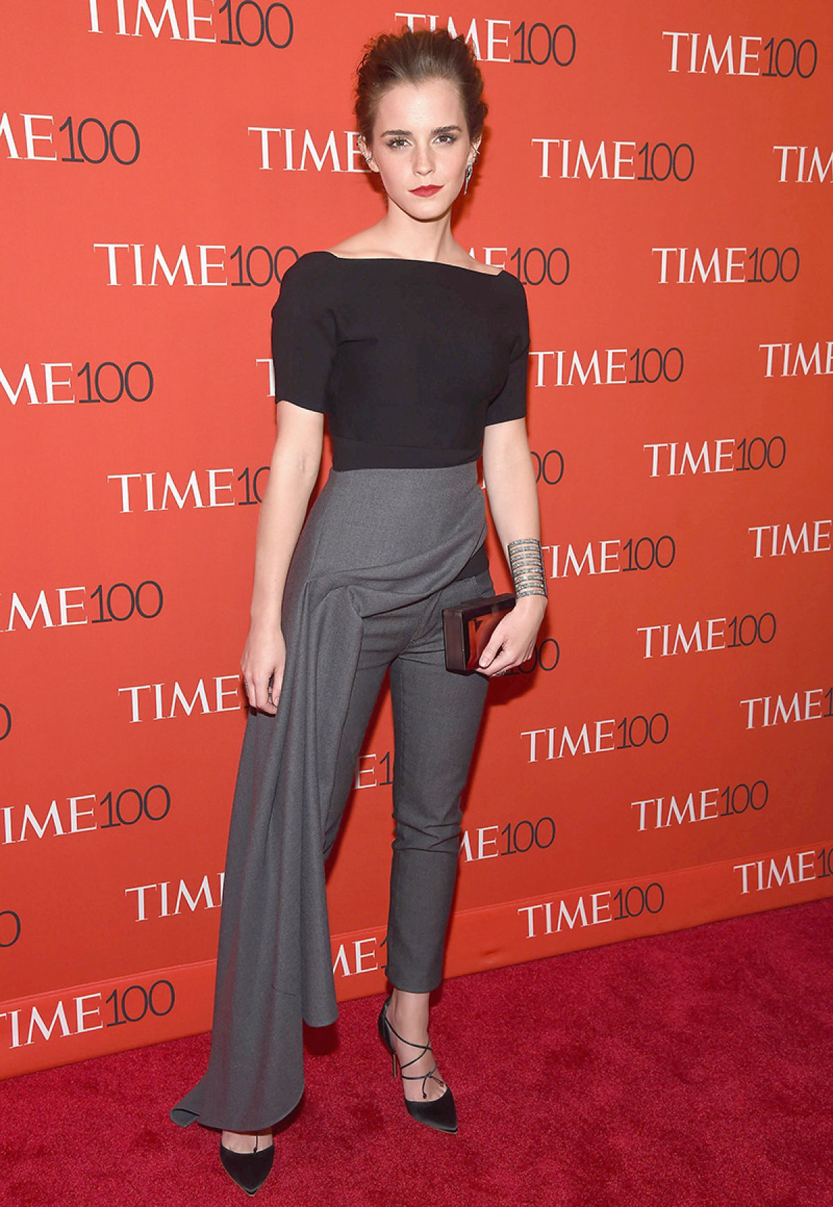 Emma Watson in a black shirt and dark grey skirt-pants hybrid outfit