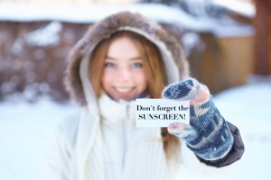 Young beautiful girl with blank visiting card. Winter.
