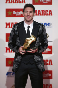 Barcelona's soccer player Messi holds the Golden Boot trophy during an award ceremony in Barcelona