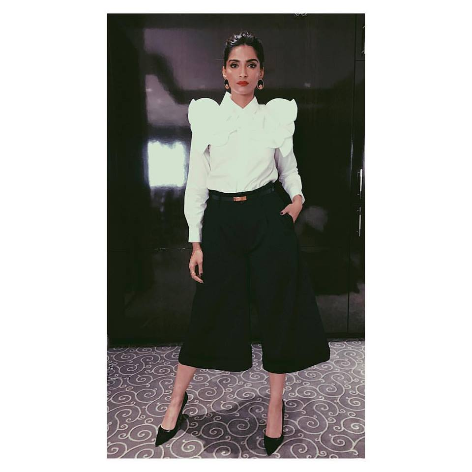 16db0e90ea Sonam Kapoor gives us a lesson to dress up in the chicest way possible. She  totally slays the formal game with a structured white blouse and a pair of  black ...